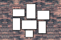 Group of blank black picture frame on the old brick wall with co. Py space for moc up your product display Royalty Free Stock Photo