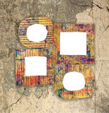 Group of blank colorful painted cardboard frames. On grunge wall Royalty Free Stock Images