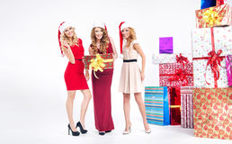 Group of blondies with Christmas gifts Stock Photography