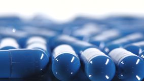 Group of blue medical pills, rotation, close up. Group of the same blue medical pills, rotation, close up, on white background stock footage