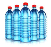 Group of blue plastic drink water bottles. 3D render illustration of the group of five blue plastic bottles with clear purified drink carbonated water isolated Stock Images