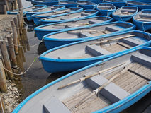 Group of blue rowboat at river Stock Images