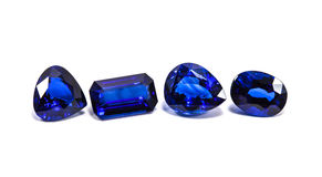 Group of the blue sapphires. On white background Royalty Free Stock Photo
