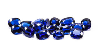 Group of the blue sapphires. On white background Royalty Free Stock Photography