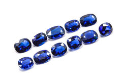 Group of the blue sapphires. On white background Royalty Free Stock Photos