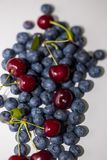 Group of blueberries and cherries on the table, closeup, selective focus royalty free stock photos