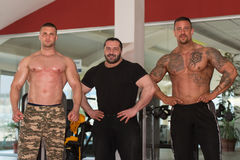 Group Of Bodybuilders Posing in Gym Stock Photos