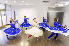 Group of bollywood dancers. Group of  bollywood dancers in dance studio Stock Image