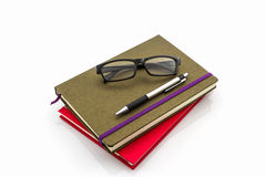 Group of book ,pen and glasses. Royalty Free Stock Images