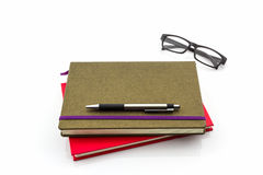 Group of book ,pen and glasses. Stock Photos