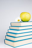Group of books. Group of blue book, yellow apple and white flowers Royalty Free Stock Photos
