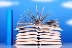 Group of books. With the sky in the background royalty free stock image
