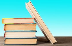 A group of books on a wooden surface folded vertically royalty free stock photo