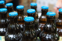 Group bottles of craft beer wuth blue caps stock images
