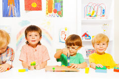 Group of boys in classroom with toy work tools Stock Photo