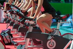 Group of Boys and Girls at Gym: Workout with Spinning Bikes.  Stock Image