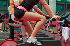 Group of Boys and Girls at Gym: Workout with Spinning Bikes.  Stock Photo