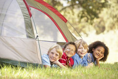 Group Of Boys Having Fun In Tent In Countryside Stock Photography