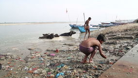 Group of boys playing at dirty shore of Ganges. stock footage