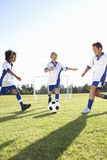 Group Of Boys Playing Football Royalty Free Stock Photos