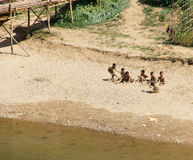 Group of Boys Playing on River Bank in Laos Stock Images