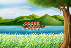 A group of boys riding on a boat Stock Image