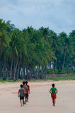 Group of Boys Walking at The sand Beach in front o Royalty Free Stock Photos
