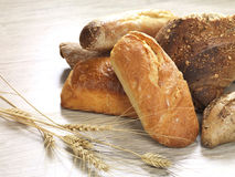 Group of bread. Different types of bread on a wooden surface royalty free stock images