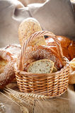 Group of bread loaves buns rolls on the wooden table Stock Images