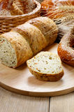 Group of bread loaves buns rolls on the wooden table Royalty Free Stock Photo