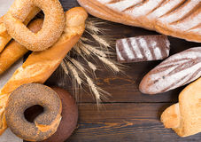 Group of bread products on wood table Royalty Free Stock Photos