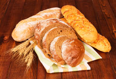 Group of bread with wheat ears Stock Images