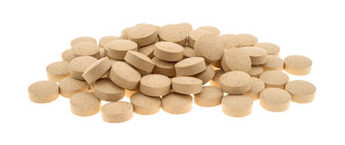 Group of brewer's yeast nutritional supplement tablets on whit Royalty Free Stock Image
