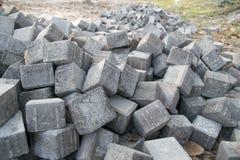 Group of bricks gray square construction materials Stock Photos