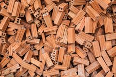 Group of bricks square construction materials. bricks texture and abstract in vignette for background or copy space for text fill. Stack of disorganized brown stock photos