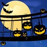 Group on the bridge on Halloween pumpkin with bat on the moon Royalty Free Stock Photos