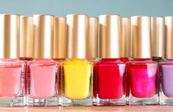 Group of bright nail polish bottles Royalty Free Stock Image