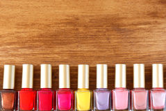 Group of bright nail polish bottles. Stock Photos