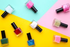 Group of bright nail polishes on colorful background stock photo