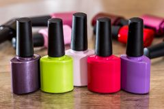 Group of bright nail polishes. On wooden desk Royalty Free Stock Image