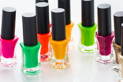 Group of bright nail polishes. On white Stock Photos