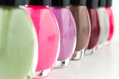 Group of bright nail polishes on white Stock Images