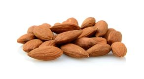 Group of brown almonds isolated on white Stock Photos