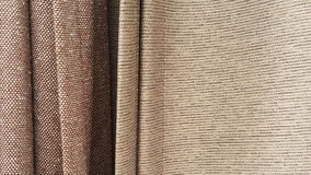 Group of brown fabric roll selection / stock of grey fabric for fashion design business Royalty Free Stock Images