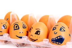 Group of brown hen's eggs with different faces Stock Photo