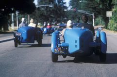 A group of Bugatti owners drive their classic cars down Route 1 during the 35th Pebble Beach Concours vintage car show, ca 1985 Royalty Free Stock Photo
