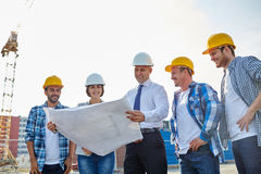 Group of builders and architects with blueprint Royalty Free Stock Photo