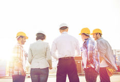Group of builders and architects at building site Royalty Free Stock Photos