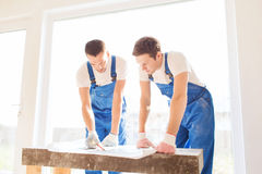 Group of builders with blueprint Stock Photo