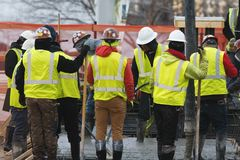 Group of builders on a construction site. Industrial concept Stock Photos